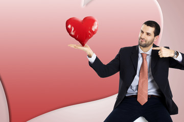business man is holding and pointing his heart