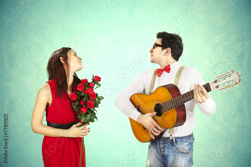 Man approaching woman playing a love song, serenade - 77881621