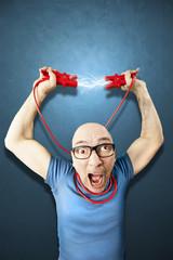 man keeps energie trough red elettric wires