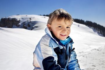 boy has fun in the mountains