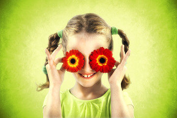 little girl cover her eyes with red flowers, spring