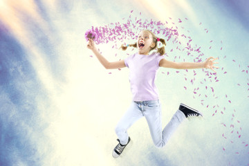 Little happy girl holding flowers on air in spring