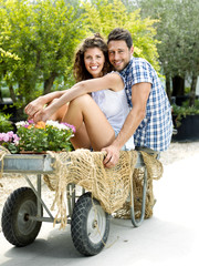 young couple  having fun in a greenhouse