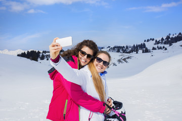 friends making a selfie on the snow