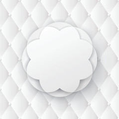White flower frame on white upholstery background.
