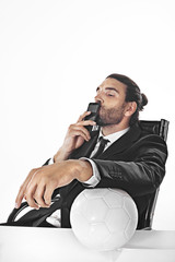 Procurator business man bets on a football match