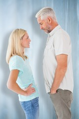 Composite image of unhappy couple having an argument