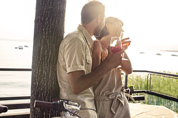 couple in love having spritz time with lake view
