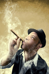 man smoking a big cigar surrounded by smoke