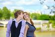 Dating couple enjoying sunny day in Paris