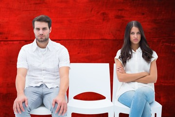 Composite image of angry couple not talking after argument