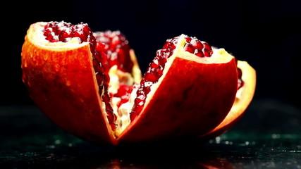 Open Pomegranate Rotates on a Dark Background