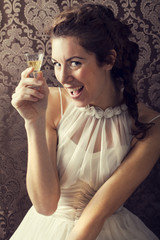 dreaming woman drinks a glass of excellent Scotch whisky