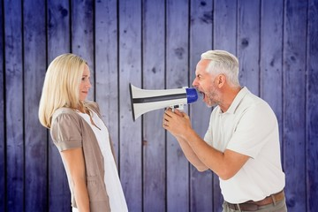Angry man shouting at girlfriend through megaphone
