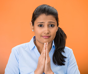 woman praying looking at you, in gratitude thankfulness