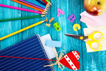 Office and school supplies on wooden surface