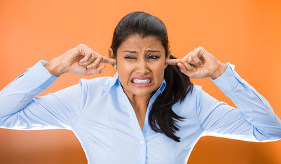 angry unhappy stressed woman covering closed ears