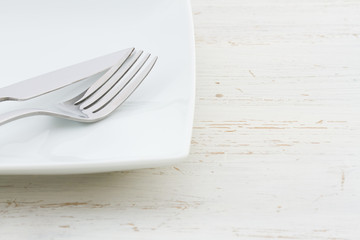 White place setting on a shabby white table