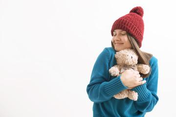 happy woman hugging a teddy bear