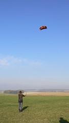 Girl flying a kite (landkiting) during sunny winter day