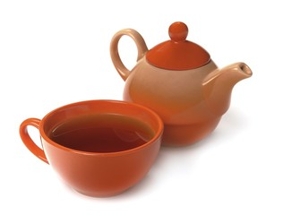Orange cup of tea and teapot on a white background