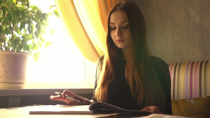 female student preparing for the exam reading