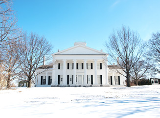 manor home in winter