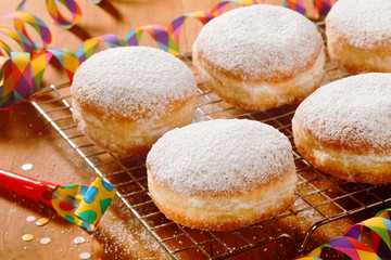 Tasty Sugared Round Donuts on Table