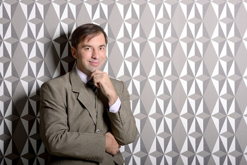Business man standing near the wall - stock photo