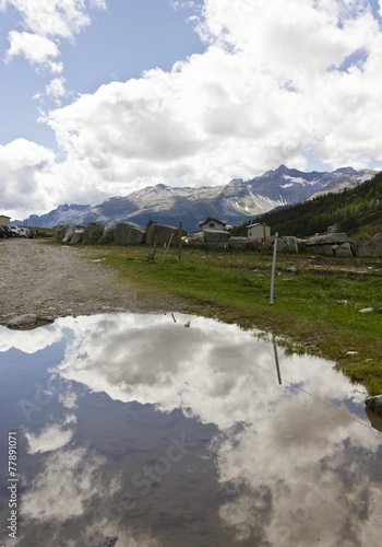 Mountain path in Madesimo, with reflection in the puddle © greta gabaglio