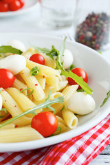 Penne with cherry tomatoes and mozzarella cheese
