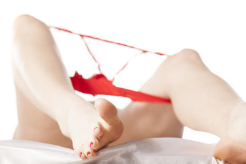 women's legs and panties over a knee. Masturbation concept