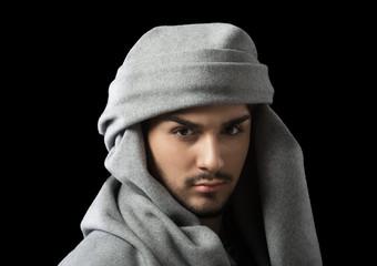 Man wearing a turban, studio portrait, dark background