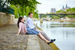 Couple is sitting on the embankment