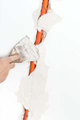 Repairman Covering the Cable Duct with Cement