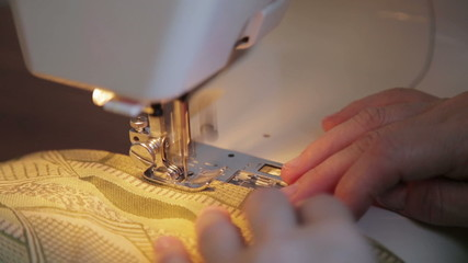Tailor works on sewing machine