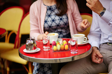 Coffee or tea and macaroons in a Parisian cafe