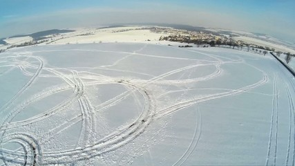 winter landscape wit all terrain marks