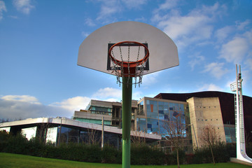 View of basketball board and hoop in an urban background