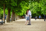 Couple hugging in the Luxembourg garden of Paris