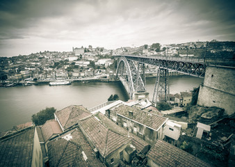 Red tiled roofs, metal bridge, old houses and the river Douro in