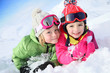 Portrait of kids enjoying winter vacation at ski resort - 77895256