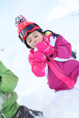 Little girl blowing snow flakes