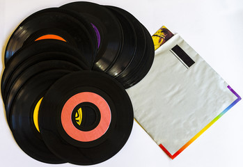 Old beat up 45s and their paper sleeves