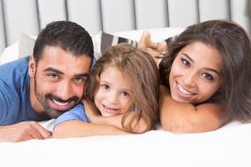 Family on bed