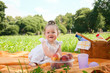 Adorable little girl on picnic in the beauty park