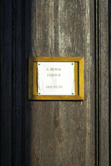 Old church entrance door. Color image
