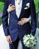 Bride hugging groom. - 77896836