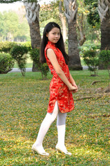Asia female teenager wear red suit pose for take photo in garden