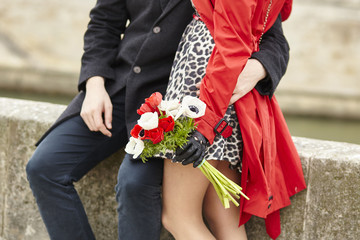 Dating couple with bunch of flowers